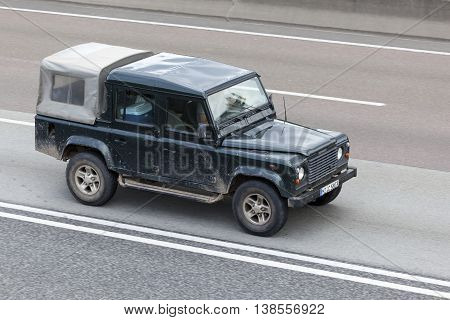 FRANKFURT GERMANY - JULY 12 2016: Land Rover Defender on the highway in Germany