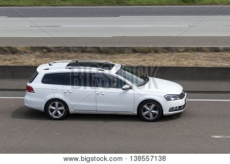 FRANKFURT GERMANY - JULY 12 2016: Volkswagen Passat Estate large family car on the highway in Germany
