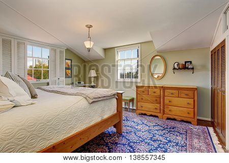Cozy And Comfortable Atmosphere In The Bedroom With Wooden Furniture Set And Colorful Rug.