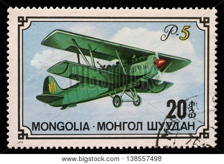 ZAGREB, CROATIA - SEPTEMBER 08: A stamp printed in Mongolia shows biplane P-5, series, circa 1976, on September 08, 2012, Zagreb, Croatia