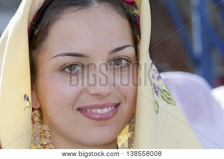 CAGLIARI, ITALY - May 1, 2014: 358 ^ Religious Procession of Sant'Efisio - Sardinia - portrait of a beautiful smiling girl in traditional Sardinian costume