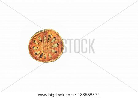 Dried bael or dried aegle marmelos isolated on white background