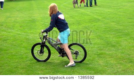 Beautiful Girl/Teenager  Riding Her Bicycle