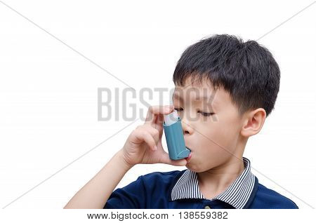 Asian boy using inhaler for asthma over white background