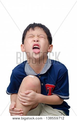 Asian boy with wound on knee cover by plaster over white background