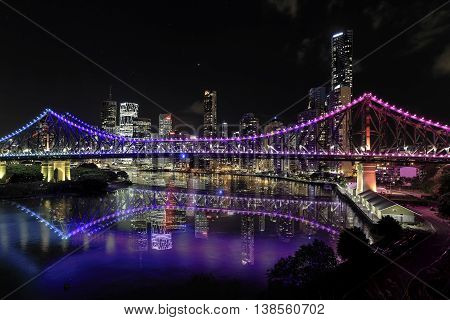 BRISBANE, AUSTRALIA: Story Bridge by night, reflections on the river.