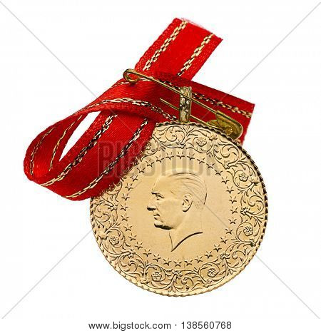 Whole Turkish gold coin with ribbon isolated on white background.  (Back view)
