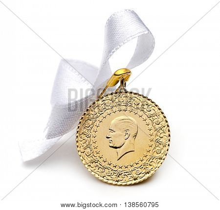 Half Turkish gold coin back view with white ribbon isolated on white background.