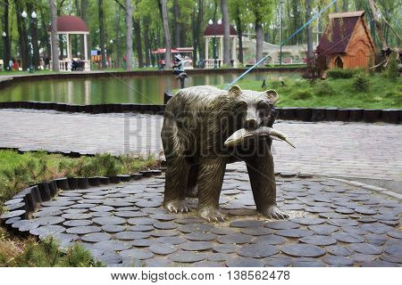 KHARKIV UKRAINE - MAY 3 2015: Monument to the bear with a fish in his mouth at Gorky Park in Kharkiv
