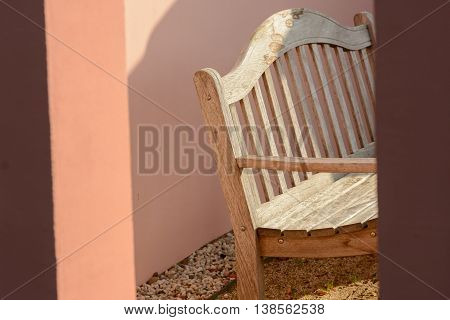 Wooden bench in mediterran garden house outside