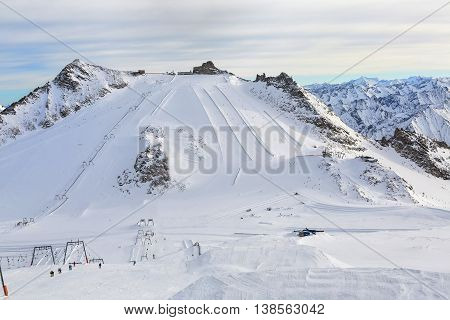 Hintertux Glacier with gondolas ski runs and pistes in Ziilertal Alps. Austria