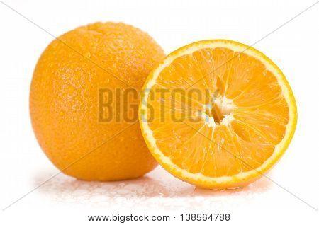Fresh orange fruit and orange slice with water drops