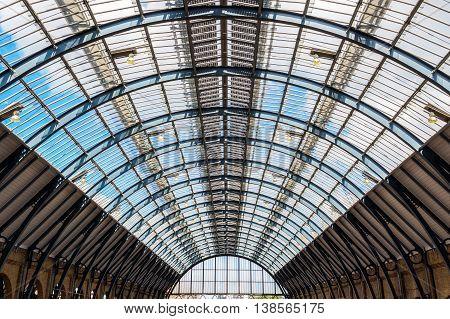 London, UK - July 5, 2016 - Ceiling arch of Kings Cross train station in London UK