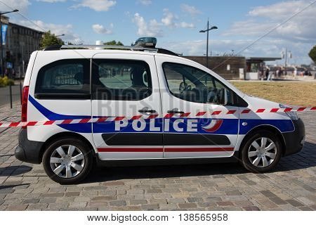 Car of police under blue sky in the street