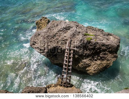 Wooden Staircase Attached To Rock In The Sea
