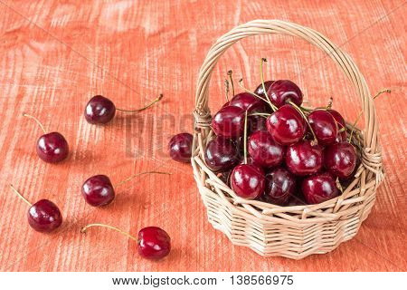 Wicker Basket Of Fresh Cherry Fruit