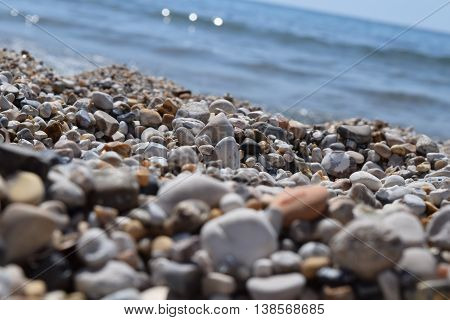 Beautiful colourful pebbles on the beach by the sea in Corfu.