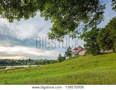 Evening landscape with a castle in Svirzh, Ukraine