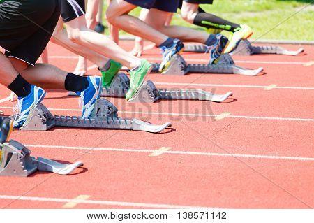 Athletics (sprint). Start athletes from Athletics starting blocks.