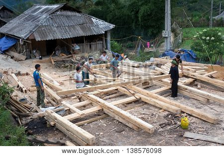 SAPA, VIETNAM, February 12, 2016 the group of Hmong men, highland Sa Pa, Vietnam, building wooden houses