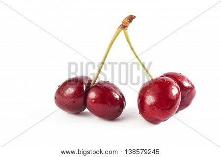 Mutated cherries on white background. Food concept