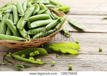 Green Peas On A Grey Wooden Table