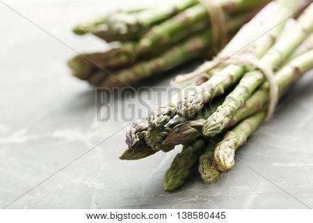 Fresh Green Asparagus On A Grey Table