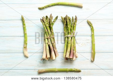 Fresh Green Asparagus On A Blue Wooden Table