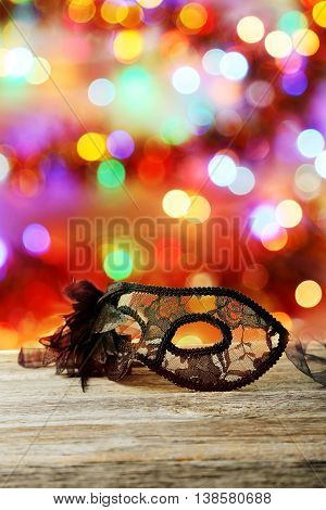 Female carnival mask on grey wooden background