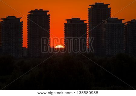 Sunset Over Skyscrapers. Silhouette Panorama At Sunset With Skyscrapers. Sunset Over The Cities Silh