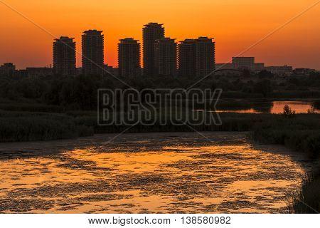 Sunset Over Bucharest City. Sunset Over Skyscrapers Near Vacaresti Lake. Sunset In Bucharest Delta.
