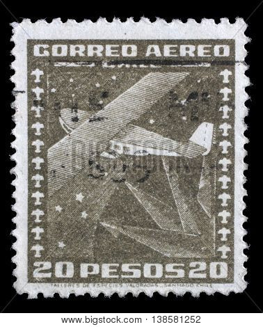 ZAGREB, CROATIA - JUNE 24: A stamp printed in Chile shows stylized Dornier Wal flying boat and compass, circa 1934, on June 24, 2014, Zagreb, Croatia