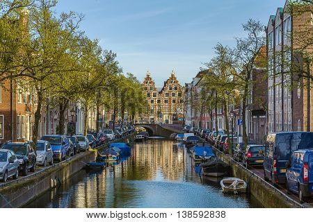 View of canal in Haarlem with historic houses and boat Netherlands