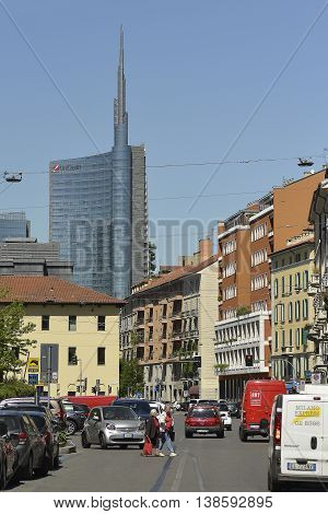 Milan Italy - April 19 2016: Milan Brera district new and old city contrast Unicredit Tower view from San Marco street