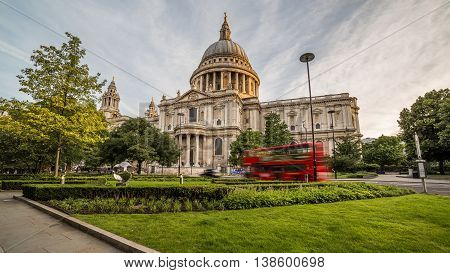 LONDON UK - 6TH JULY 2016: A view of St Pauls Cathedral in central London in the morning. A red bus can be seen going past.