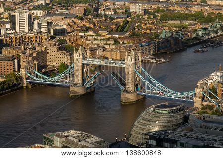 LONDON UK - 5TH JULY 2016: A view towards Tower Bridge whilst the bridge is raised to allow boats to travel through it.