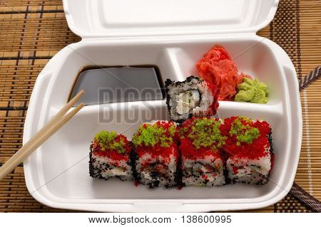 sushi rolls in a white plate close up