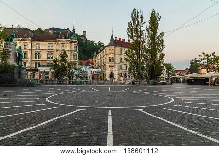 LJUBLJANA SLOVENIA - 27TH MAY 2016: A view towards Town Square Ljubljana Castle and Triple bridges during the morning from Preseren Square. Buildings can be seen.
