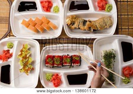 assorted sushi and rolls on the table, top view