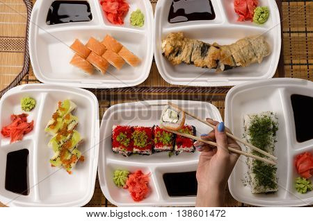 assorted sushi and rolls on the table