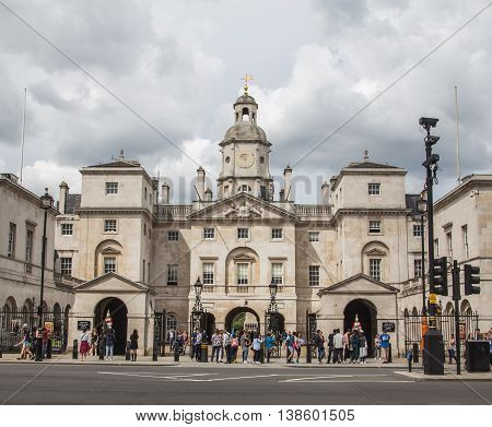 LONDON UK - 28TH JUNE 2016: A view of the outside of Horse Guards Parade in London during the day. People can bve seen outside.