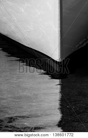 High Contrast of Boat Bow in Water in black and white