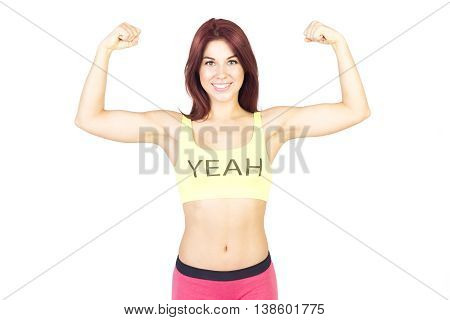 Sport smiling woman shows off his muscles . Sports and fitness concept