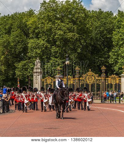 LONDON UK - 28TH JUNE 2016: Musicians at the Changing of the Guard Performance at Buckingham Palace in the summer. A police escort can be seen.