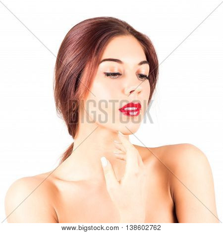 Beautiful woman with red lips touching chin. Make up with red lips.