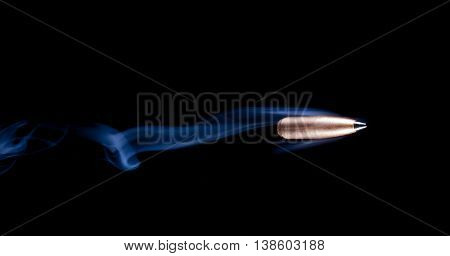Copper plated lead bullet with a polymer tip and smoke behind