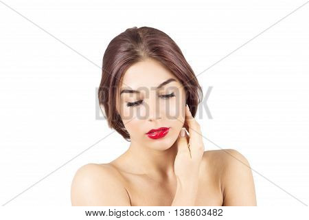 Woman with red lips touching face. Beauty woman looking down.