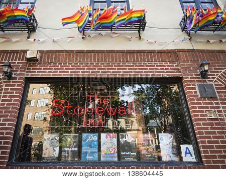 NEW YORK-JULY 12 2016: The Stonewall Inn, site of the 1969 riots on Christopher St. President Obama designated the area around the iconic bar as the country's first national monument to LGBT rights.
