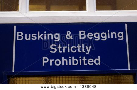 Sign. Busking & Begging Strictly Prohibited