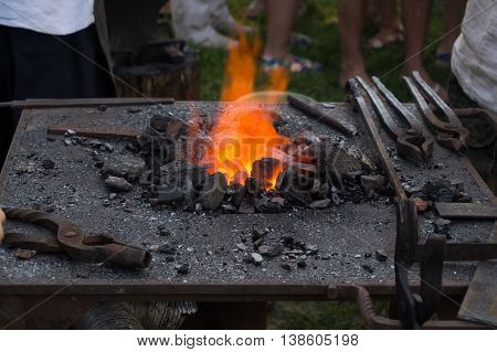 The old red-hot hearth and blacksmith tools
